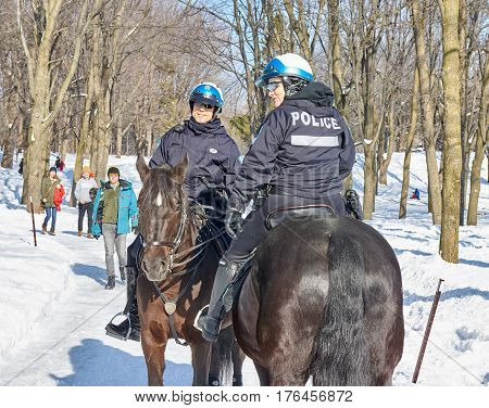 MONTREAL CANADA - FEBRUARY 2 2017: - Montreal Mounted Patrol officers in Mont-Royal park.