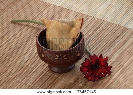 Indian Food Spicy Samosa with a flower