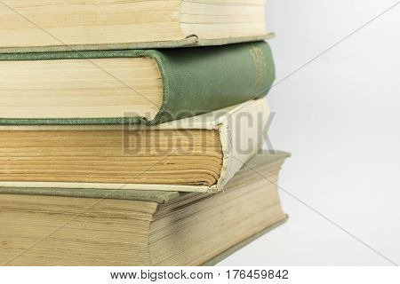 Stacked old bound and yellowed book as background picture