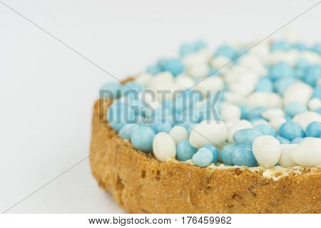 Rusks with blue anise sprinkles is a Dutch tradition related to the celebration of the birth of a boy. Sprinkles are sugared anise seeds that serve as sweet toppings.