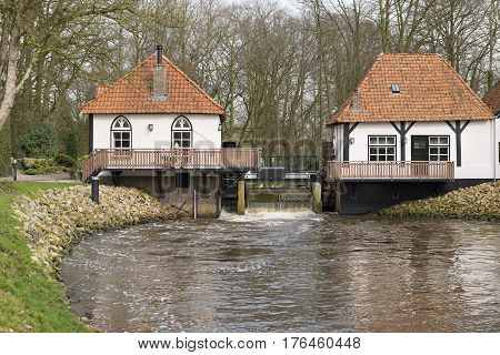 The recently restored historic water mill called The Olliemölle or Den Helder in the stream of the river the Boven-Slinge in Winterswijk in Hamlet the Achterhoek in the Netherlands. The water mill is a national monument and the restoration is completed in