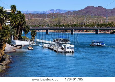 March 1, 2017 in Laughlin, NV:  Water Taxi transporting people to different dock locations on the Colorado River in Laughlin, NV where people ride the water taxi from one casino hotel to another on the riverfront boardwalk taken in Laughlin, NV