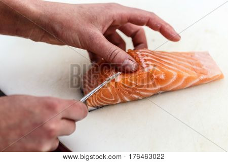 Chef Removing Fish Bone From Salmon