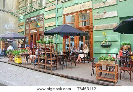 LVIV, UKRAINE - JULY 17, 2015: Open air restaurant located on Drukarska Street 2, Lviv, Ukraine
