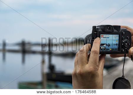 Female hands taking a photo of landscape
