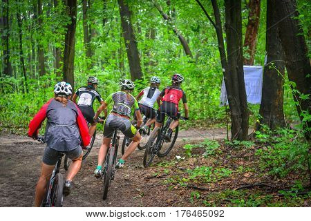 Lviv Ukraine - August 17 2016: Group of young women MTB cyclists competing in the forest near Lviv in Ukraine at 4th round of amateur xc cup of Ukraine 2016.