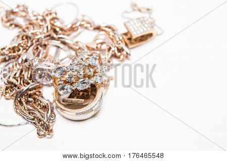 Beautiful golden jewelry. Many fashionable women's jewelry. Macro shot.