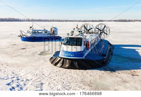SAMARA RUSSIA - MARCH 11 2017: Passenger Hovercrafts on the ice of the frozen Volga river in Samara Russia