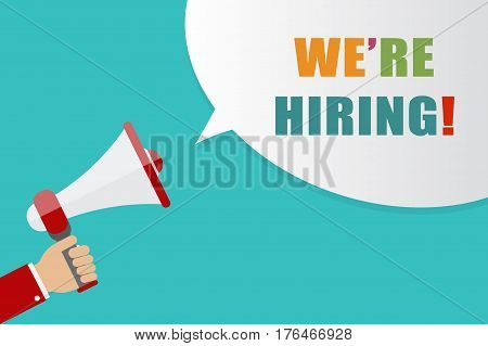 Hand holding Megaphone with speech bubble on blue background with words we're hiring vector illustration