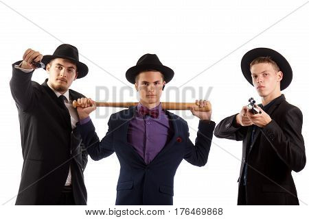 Three guys in fancy suits with weapons