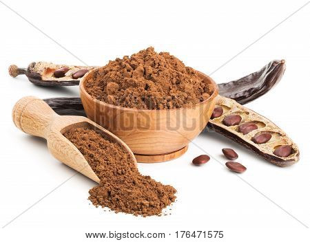 Ground carob and pods isolated on white background. Deep focus