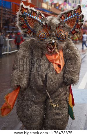 ORURO, BOLIVIA - FEBRUARY 25, 2017: Diablada dancer in ornate bear costume parading through the mining city of Oruro on the Altiplano of Bolivia during the annual carnival.