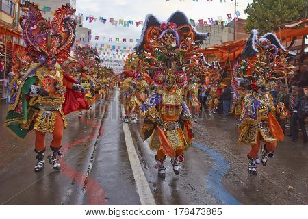 ORURO, BOLIVIA - FEBRUARY 25, 2017: Diablada dancers in ornate costumes parade through the mining city of Oruro on the Altiplano of Bolivia during the annual carnival.