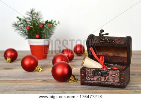 Christmas wish list in old wooden treasure chest
