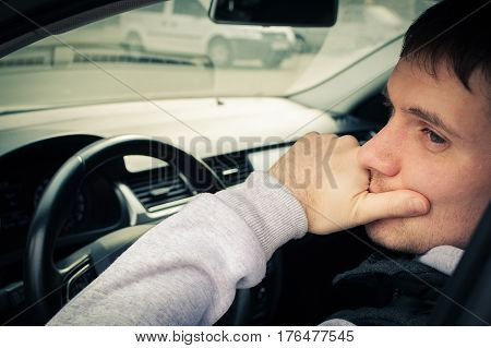 Driving Safety. A Young Man Driving A Car