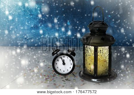 Happy New Year card with lantern and clock showing midnight
