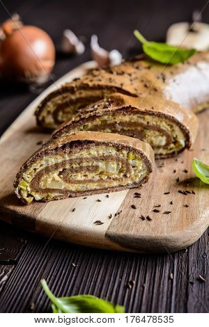 Savory Whole Wheat Roulade Stuffed With Tofu Cheese, Onion, Garlic And Herbs
