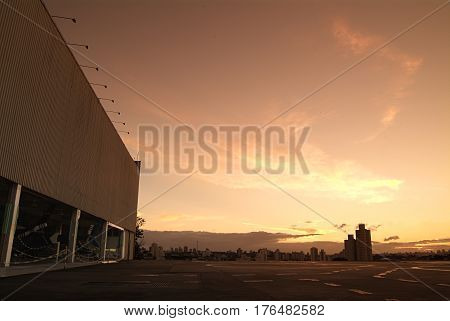 Hangar in the background silhouette of the city building with sunset