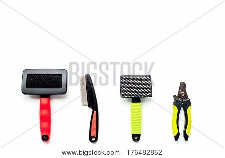 pet care and grooming tools concept on white desk background top view mock up