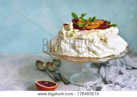 Meringue Cake Pavlova With Orange And Citrus Syrup.