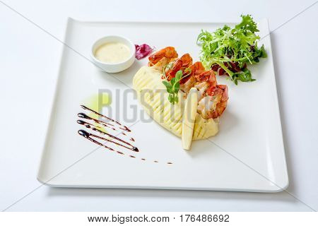 Fried Shrimps With Mashed Potatoes With Sauce On A White Plate Garnished With Fresh Lettuce. Stir Fr
