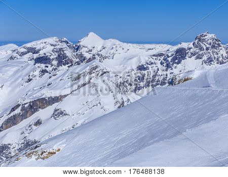 Summit of the Swiss Alps, view from Mt. Titlis in winter. The Titlis is a mountain in Switzerland, located on the border between the Swiss cantons of Obwalden and Bern.