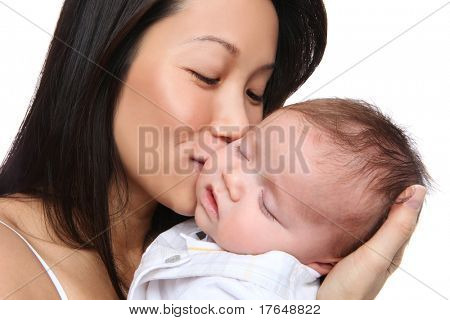A mother holding baby son with love while he is sleeping
