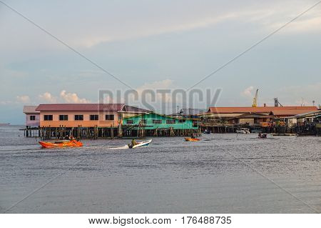 Labuan,Malaysia-March 15,2017:Evening scene of daily activities at Patau-Patau water village in Labuan,Malaysia.Patau-Patau water village is among famous place in Labuan Pearl Of Borneo,Malaysia.