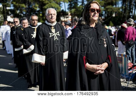 Fatima Portugal - May 13 2014: Knights of the Order of Malta at the Sanctuary of Fatima during the celebrations of the apparition of the Virgin Mary in Fatima Portugal.