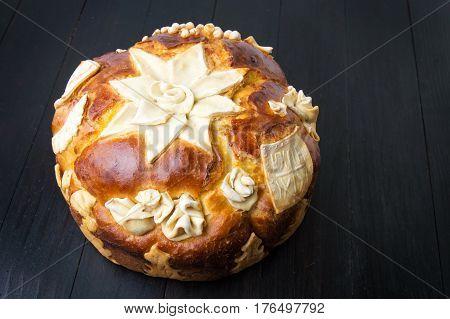 Homemade decorated Serbian slava bread cake on black