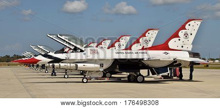 TITUSVILLE - MARCH 13: US Air Force Thunderbords team makes a stop over in Titusville Florida on March 13 2017 on their way to an airshow. Pictured are a row of their F-16 aircraft.