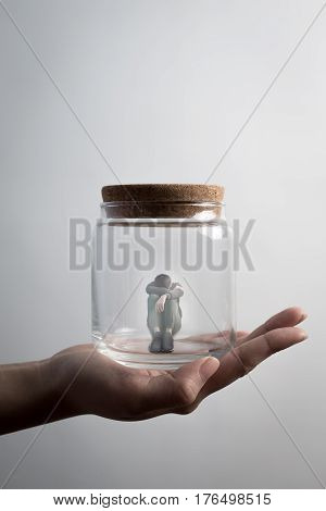 the depression man sit imprisoned in jar