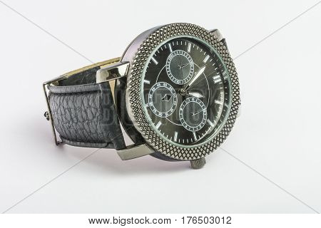 Black men's Quartz watch on a leather strap on a table on a white background