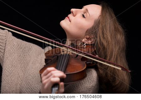 Violinist Woman Playing With Closed Eyes