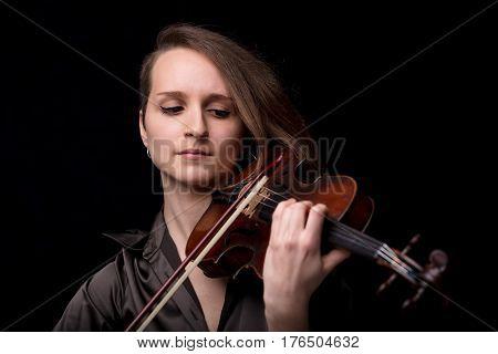 Front View Portrait Of A Violinist Woman