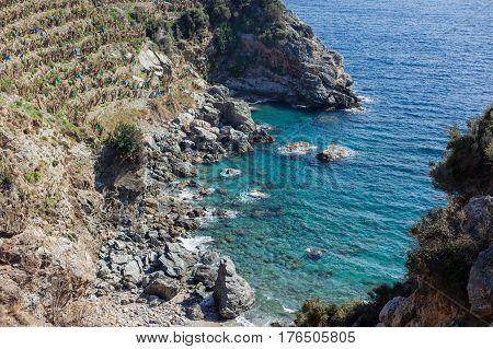 Beautiful Lagoon With Turqoise Sea And Rock Ribbed Shore