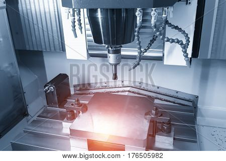 The CNC milling machine cutting the sample part with the flat endmill in light blue scene and lighting effect