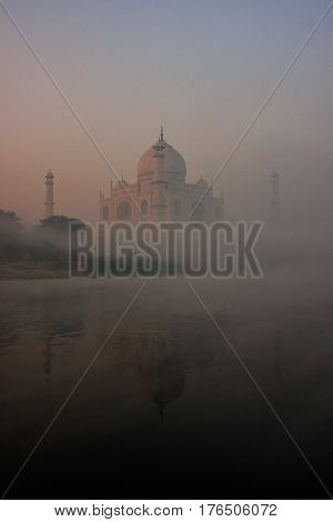 View Of Taj Mahal Reflected In Yamuna River With Early Morning Fog, Agra, Uttar Pradesh, India
