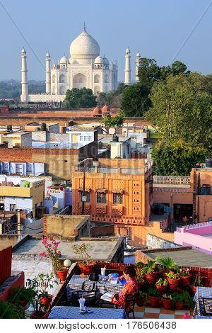 View of Taj Mahal from the rooftop restaurant in Taj Ganj neighborhood in Agra India. Taj Mahal was build in 1632 by Emperor Shah Jahan as a memorial for his second wife Mumtaz Mahal.