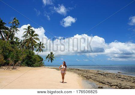 Young Woman In Bikini Standing On The Beach Of Makaha'a Island Near Tongatapu Island In Tonga