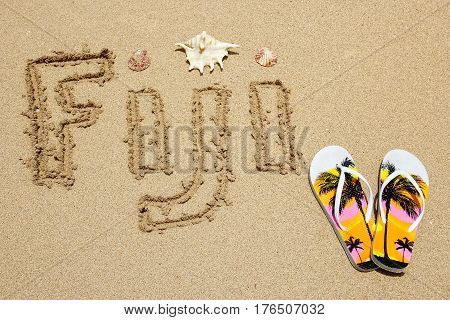 Word Fiji Written On A Beach