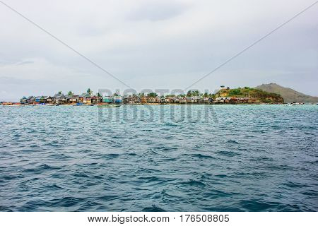 Small island with typical village in Komodo National Park Nusa Tenggara Indonesia. Komodo National Park is home to about 3500 people.