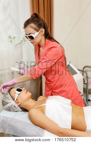Preparation of laser hair removal on the face. Hardware cosmetology. Cosmetic procedures. Spa.