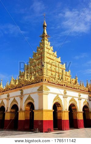Mahamuni Pagoda on a blue sky day in Mandalay Myanmar. Mahamuni Pagoda is a Buddhist temple and major pilgrimage site in Myanmar.