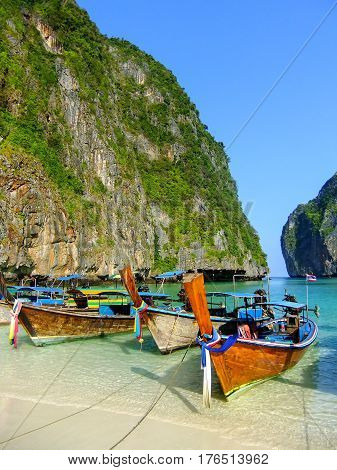 Longtail boats anchored at Maya Bay on Phi Phi Leh Island Krabi Province Thailand. It is part of Mu Ko Phi Phi National Park.