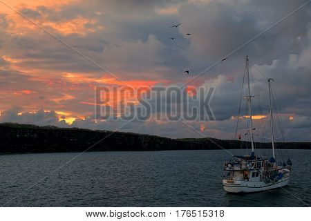 Sailboat at sunrise in Great Darwin Bay Genovesa Island Galapagos National Park Ecuador