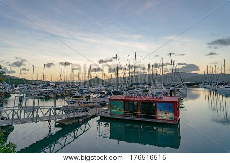 Airlie Beach, Australia - February 4, 2017: Abel Point Marina in Airlie Beach with yachts on berth and helipot