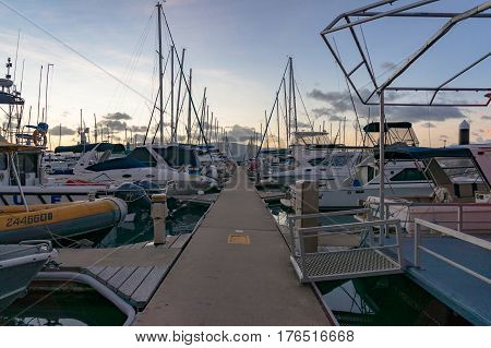 Airlie Beach, Australia - February 4, 2017: Abel Point Marina berth, mooring with yachts and boats at sunset, dusk