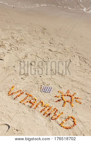 Medical Pills, Inscription Vitamin D And Shape Of Sun On Sand At Beach, Summer Time And Healthy Life