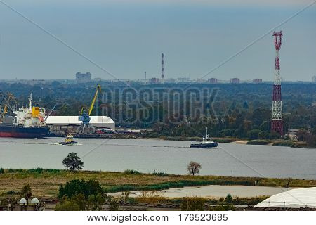 Tug Ships Moving Past The Cargo Port